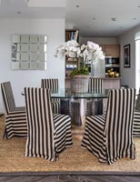 Black and white slipcovers on dining chairs