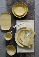 Overhead view of dining table with yellow crockery