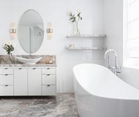 Freestanding bath in modern bathroom with marble floor