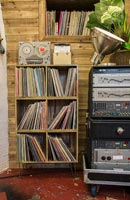 Shelves of vinyle records in music room - recording studio