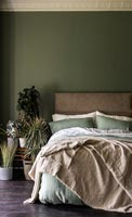 Country bedroom with dark green painted walls
