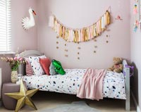 Modern childrens bedroom with tassel wall hanging
