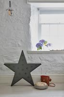 Star shaped light and binoculars case on floor of country living room