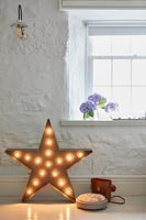 Star shaped lamp on floor of country living room