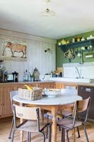 Country kitchen diner with vintage furniture