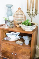 Vintage wooden cabinet with ornaments and plants