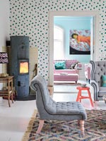 Spotty feature wall with log burning stove in modern living room