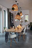 Modern dining room with concrete flooring