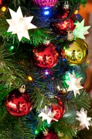 Detail of colourful modern baubles on Christmas tree