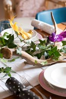 Antler and foliage as decoration on dining table at Christmas