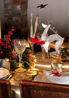 Dining room table decorated for Christmas