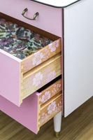 Open drawers showing stencilled pattern on the sides