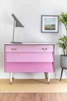 Finished set of drawers painted dusty pink with drawers in different shades - ombre paint effect.