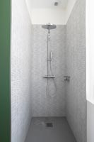 Grey tiling in modern shower cubicle