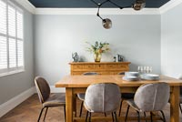 Wooden dining table in modern country dining room