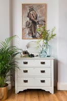 White vintage chest of drawers in bedroom