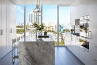Contemporary kitchen with city views through large glass wall