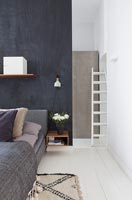 Modern bedroom with black painted dividing wall