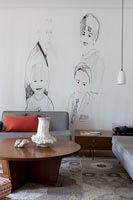 Modern living room with family portrait mural painted on wall