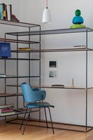 Modern shelving unit with built in desk