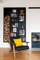 Modern living room with alcove shelving and firewood storage