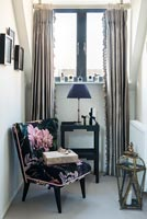 Floral armchair in tiny snug next to window