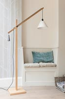 Built-in bench seat and modern wooden floor lamp