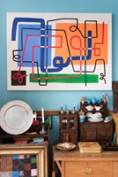 Vintage furniture and colourful artwork