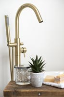 Gold mixer tap in modern bathroom