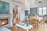 Open plan country living space with kitchen, dining and seating areas