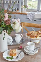 Tea and cakes on country kitchen table