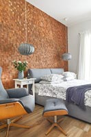 Modern bedroom with textured exposed brick wall