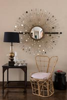 Bamboo chair and decorative vintage mirror - furniture detail