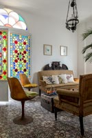 Colourful stained glass windows in living room