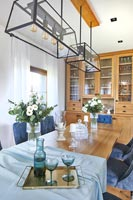 Modern dining room with blue accessories