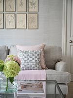 Pink and grey cushions on sofa in modern living room