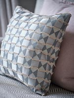 Grey patterned cushion detail