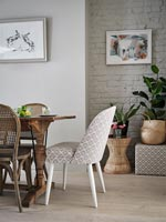 Patterned chair at head of modern dining table