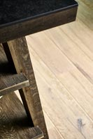 Detail of wooden kitchen island and flooring