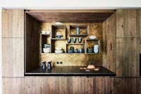 Modern wooden kitchen with wall mounted box shelves
