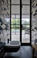 Modern bathroom with patterned tiling on wall