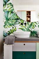 Modern bathroom with tropical leaf wallpaper