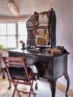 Antique dressing table in country bedroom