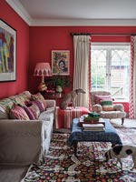 Pet dogs in colourful eclectic living room