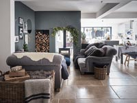 Open plan living space decorated for Christmas
