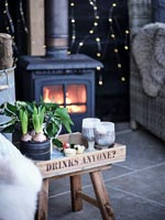 Lit wood burning stove in outdoor living area in winter