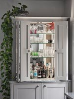Drinks cabinet open to reveal mirrored shelving