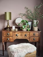 Antique wooden dressing table in bedroom