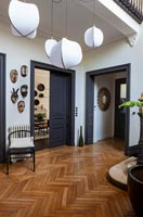 Parquet flooring in modern black and white hallway