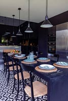 Large black dining table in modern kitchen-diner
